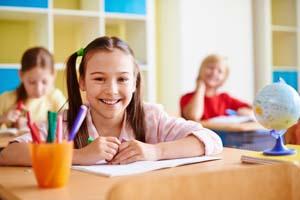 girl-with-big-smile-classroom_1098-303
