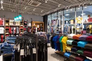 interior-shot-racks-with-shirts-undershirts-jeans_88135-5869